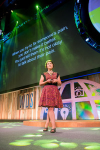 """When you try to fix someone's pain, you don't make it better. You just tell them it's not okay to talk about their pain."" Megan Devine at The World Domination Summit photo credit Armosa Studios"